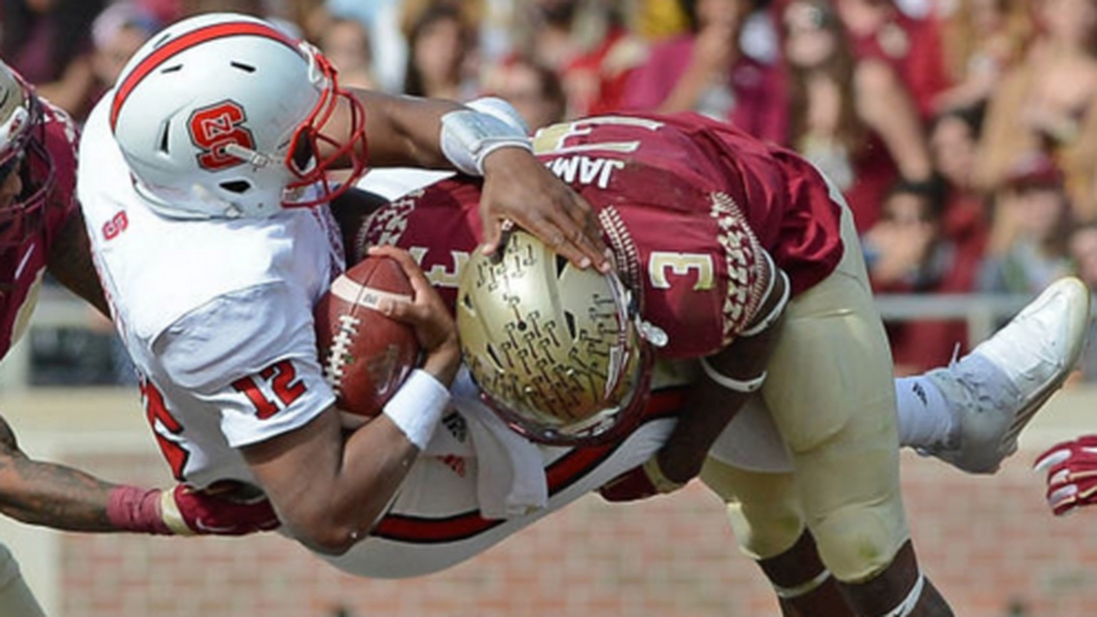 derwin james sacks nc state quarterback with the de-cleater.