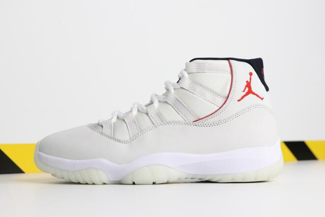2bb31d5f496295 The Nike Air Jordan 11  Platinum Tint  as they are being referred to come  in concord white and university red
